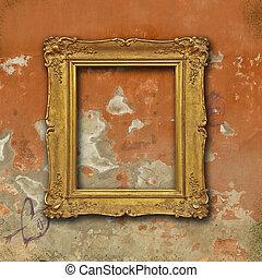 Vintage golden frame on grunge red plaster wall