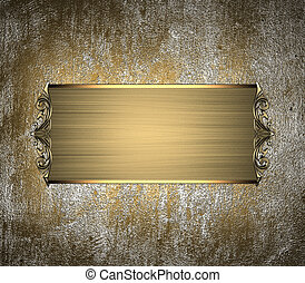 Vintage Golden metal background with a gold plate with patterns on the edges. Design template. Design for site