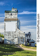 Old white grain elevator on the Canadian Prairies