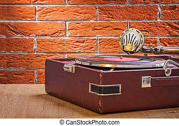 vintage gramophone on wooden table close up view