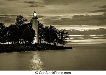 Point Aux Barques Lighthouse beacon shines over the Lake Huron coast. The light remains an active navigational beacon and has been guiding mariners home for over a century.
