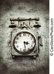 Vintage Grunge Clock on Stone Wall