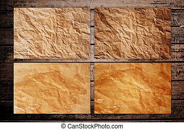 Vintage grunge paper on wood.