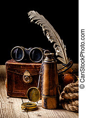 Vintage grunge still life. Antique items on wooden table....