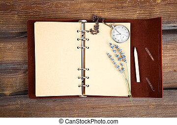 Vintage grunge still life with pocket watch, lavender flower and old book.