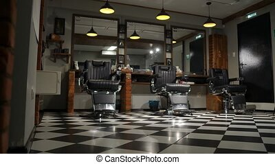 Vintage hanging lamps in hairdressing salon. Ceiling retro...