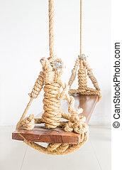 Vintage hanging swing seat on white background