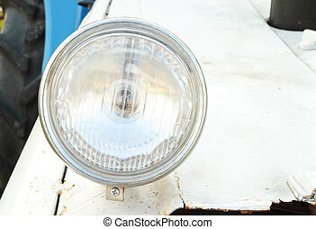 vintage headlamp on a tractor