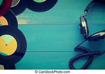 Vintage headphones with old vinyl records