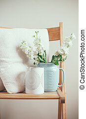 Vintage home decor, white matthiola flowers in a blue jug on...