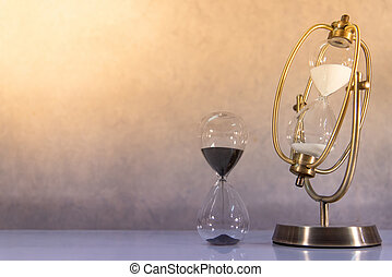 Vintage hourglass. Time passing concept
