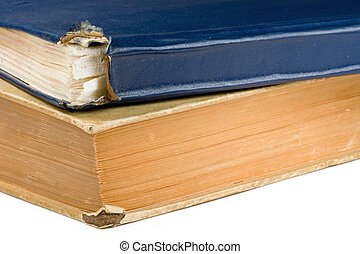 a pair of weathered old antique hymn books with a flower