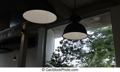 Vintage interior hanging light lamp in coffee shop, stock...