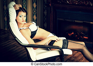 vintage interior - Seductive young woman in sexy lingerie...