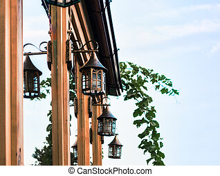 vintage iron copper lanterns with a branch of grapes in Georgia