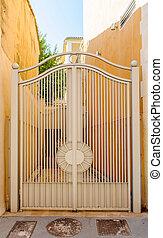 Vintage iron gates of a hous
