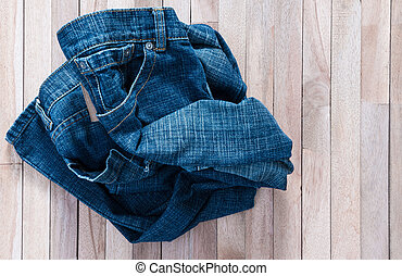 Vintage Jean on a wooden background
