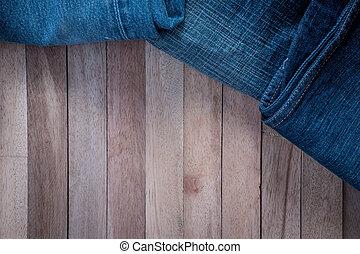 Vintage Jean on wooden background