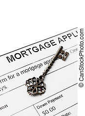 Vintage key against mortgage agreement