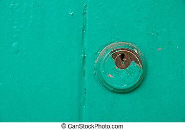 Vintage key hold on green door