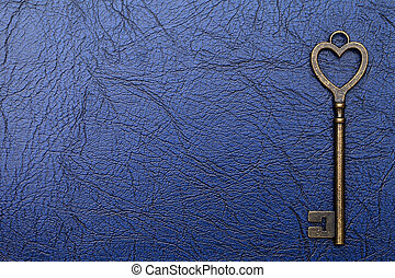 Vintage key on a leather background