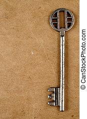 Vintage key on old paper background