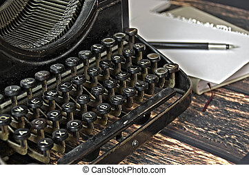 vintage keyboard of writing machine with pen