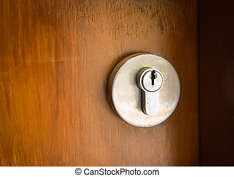 Vintage keyhole on the wooden door