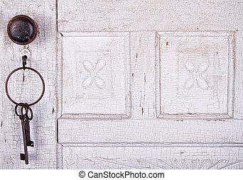 Vintage keys hanging on a vintage door