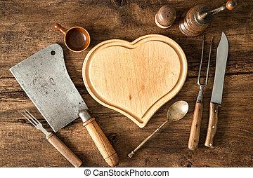 Vintage kitchen utensils on wooden table