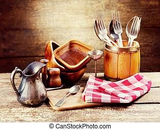 vintage kitchen utensils - kitchen utensils on rustic wooden...