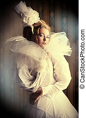 vintage lady - Beautiful fashion model in the refined white...