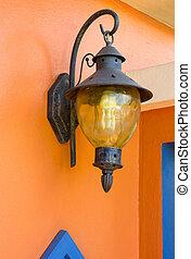 vintage lamp light on the orange wall
