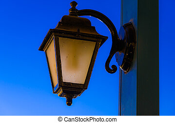 vintage lamp on a pole in the evening after sunset