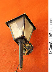 Vintage lamp on a wall
