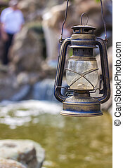 Vintage lamp on the background of a pond