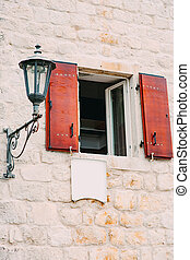Vintage lamp on the wall on street