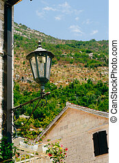 Vintage lamp on wall on street