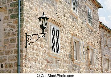 Vintage lamp on wall on street