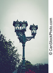 vintage lamp post in park.