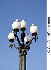 vintage lamps on blue sky background