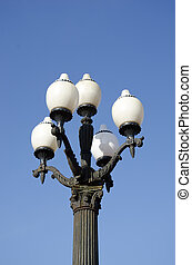 vintage lamps on blue sky background