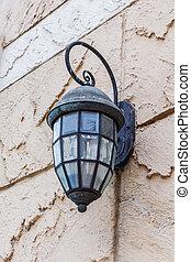 Vintage lantern on a wall