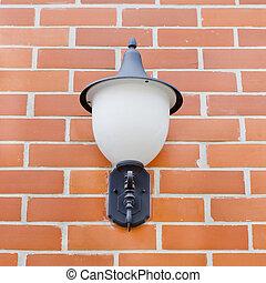 Vintage lantern on a wall.