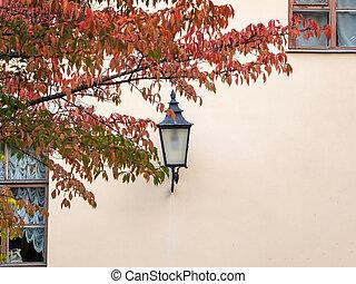 Vintage lantern on the wall in autumn
