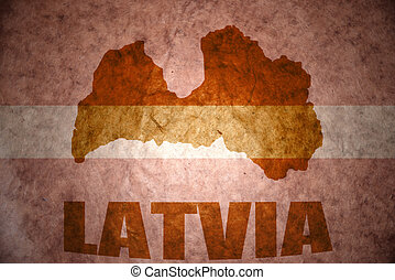 vintage latvia flag - latvia map on a vintage latvian flag...