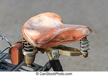 Vintage leather bike saddle with metal springs