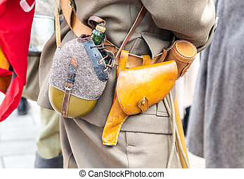 Vintage leather holster and other ammunition on the belt