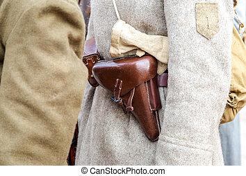 Vintage leather holster on the belt