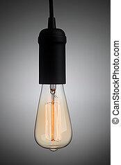 Vintage light bulb glowing